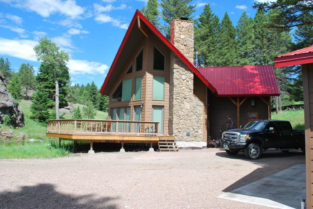 483+- ACRES OF PRIVATE ELK HUNTING AND FISHING PROPERTY WITH CUSTOM HOME AND 2 PONDS TROUT CREEK RUNS THROUGH